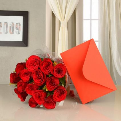 bunch of 10 red roses in a paper packing and a greeting card
